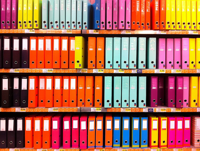 Photo of shelves full of brightly colored binders