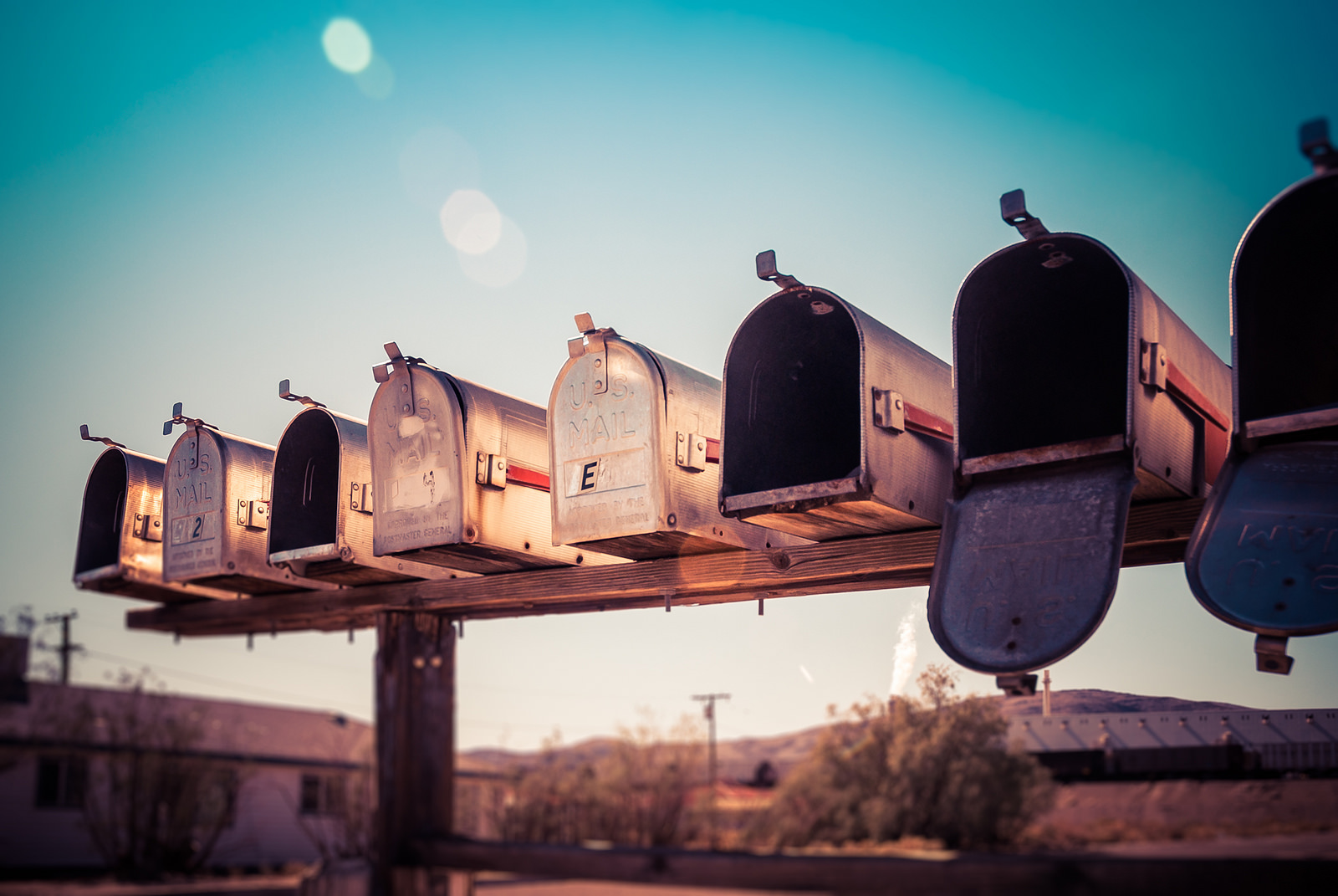 Photo of a row of mailboxes, mostly empty